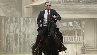 Agent Gallo on horseback